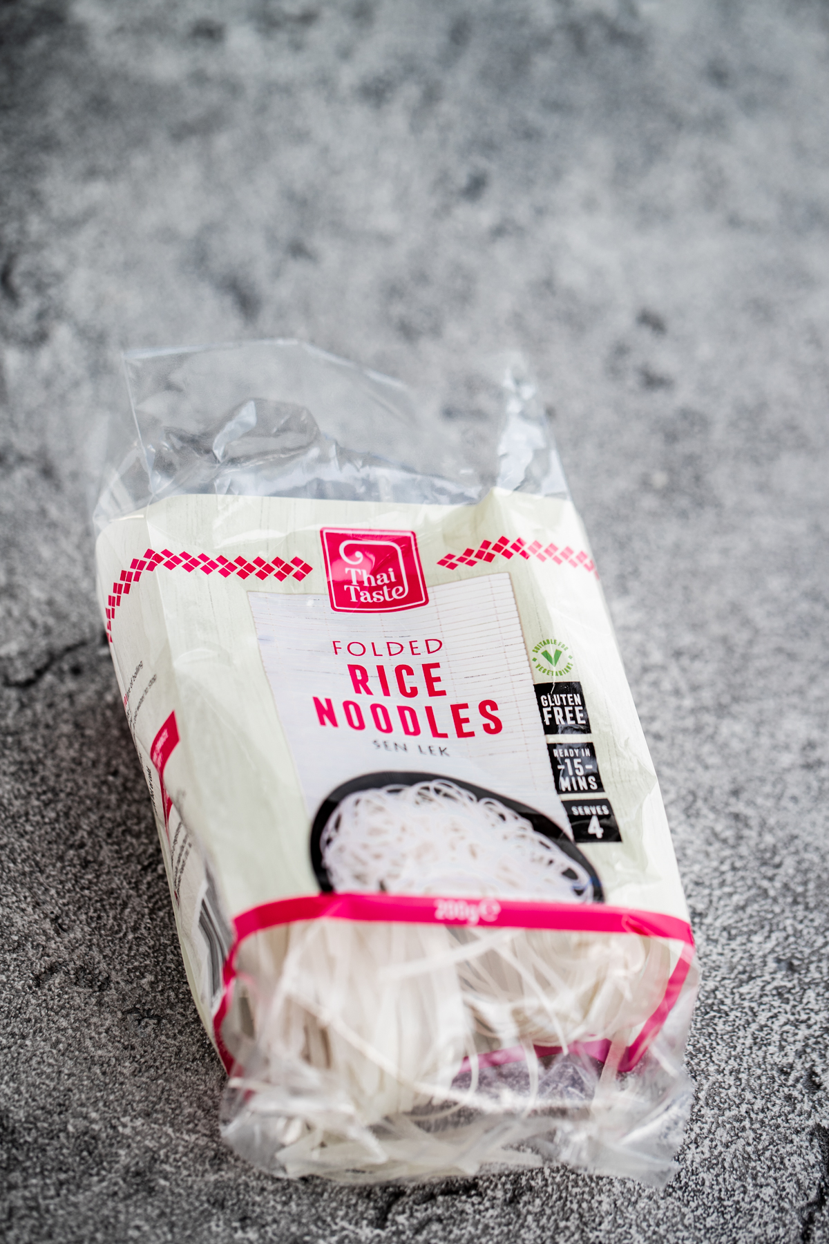 Pack of white rice noodles on a grey background
