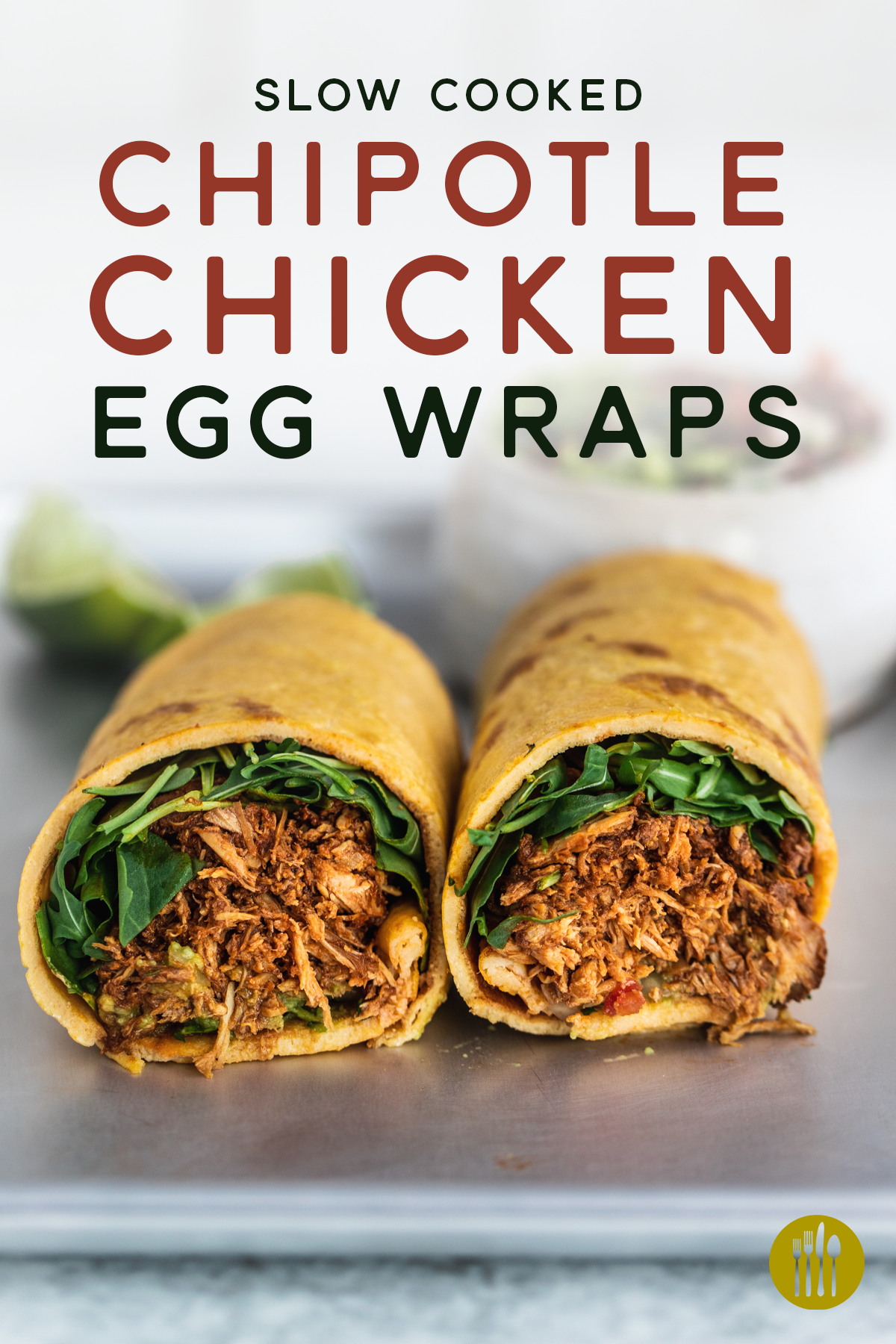Slow cooked chipotle chicken egg wraps cut in half on a silver tray